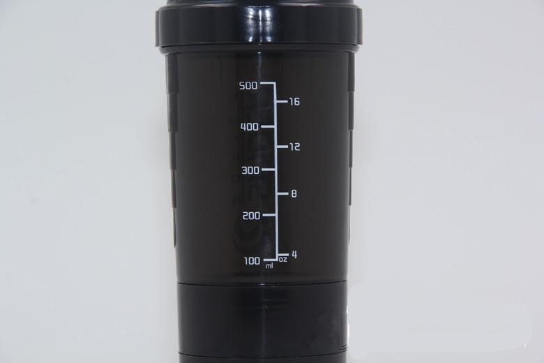 plastic protein shaker bottle with compartment on bottom and pillbox